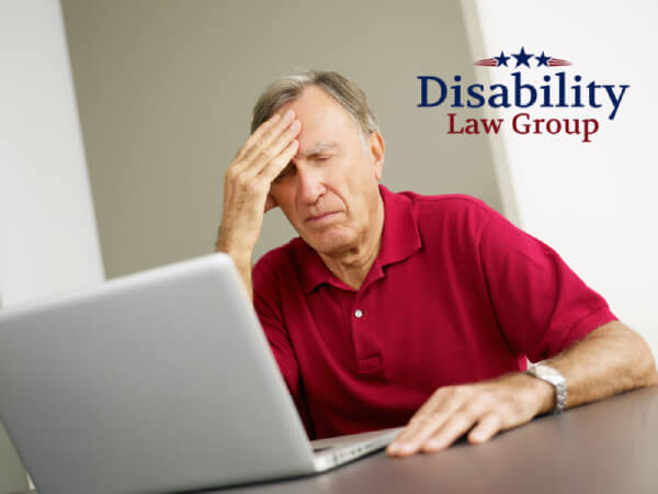 elderly man frustrated at computer