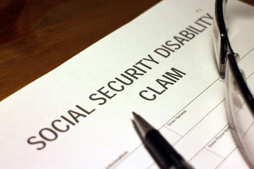 Someone filling out Social Security Disability Claim