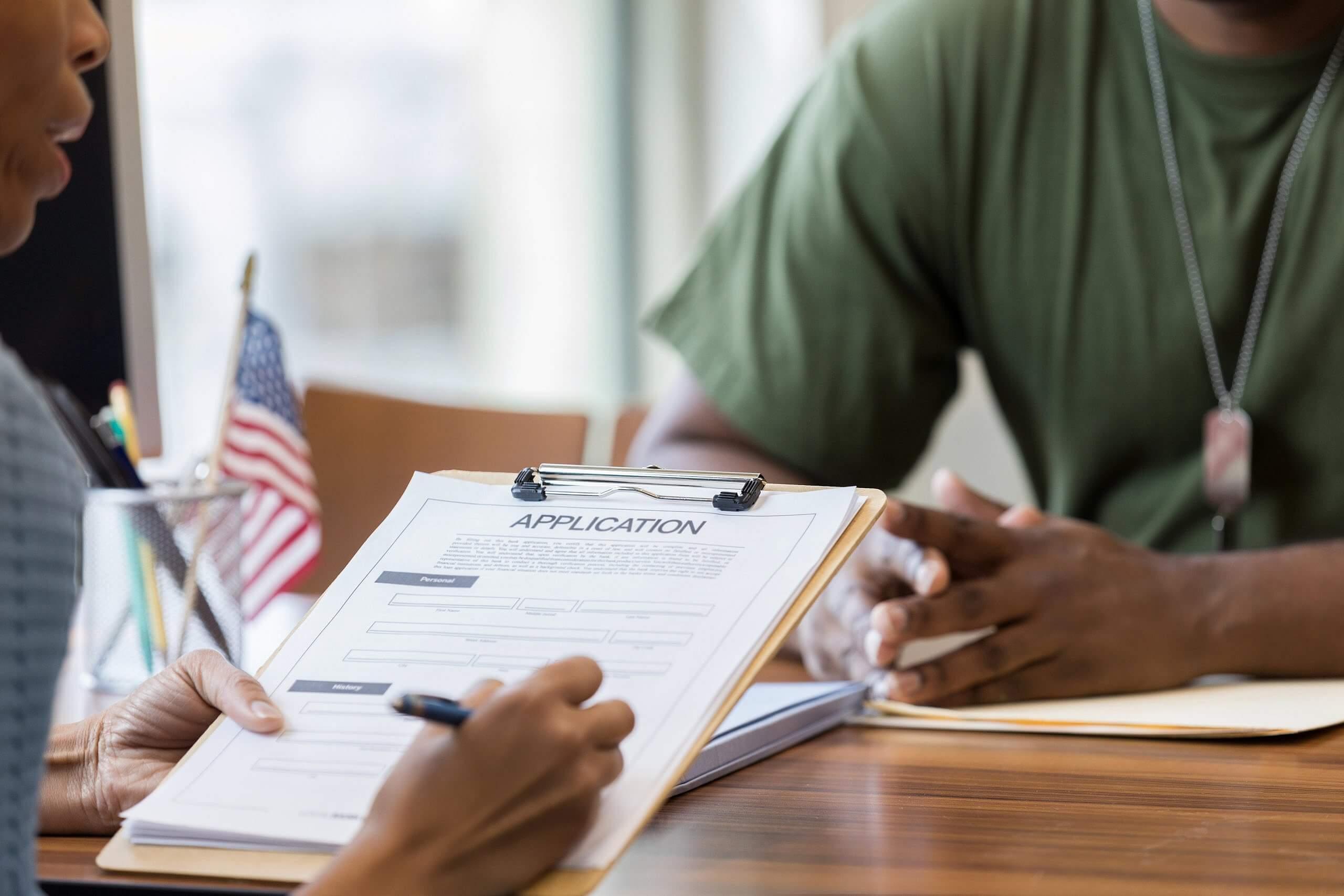 Veteran meeting with attorney to understand his VA benefits.