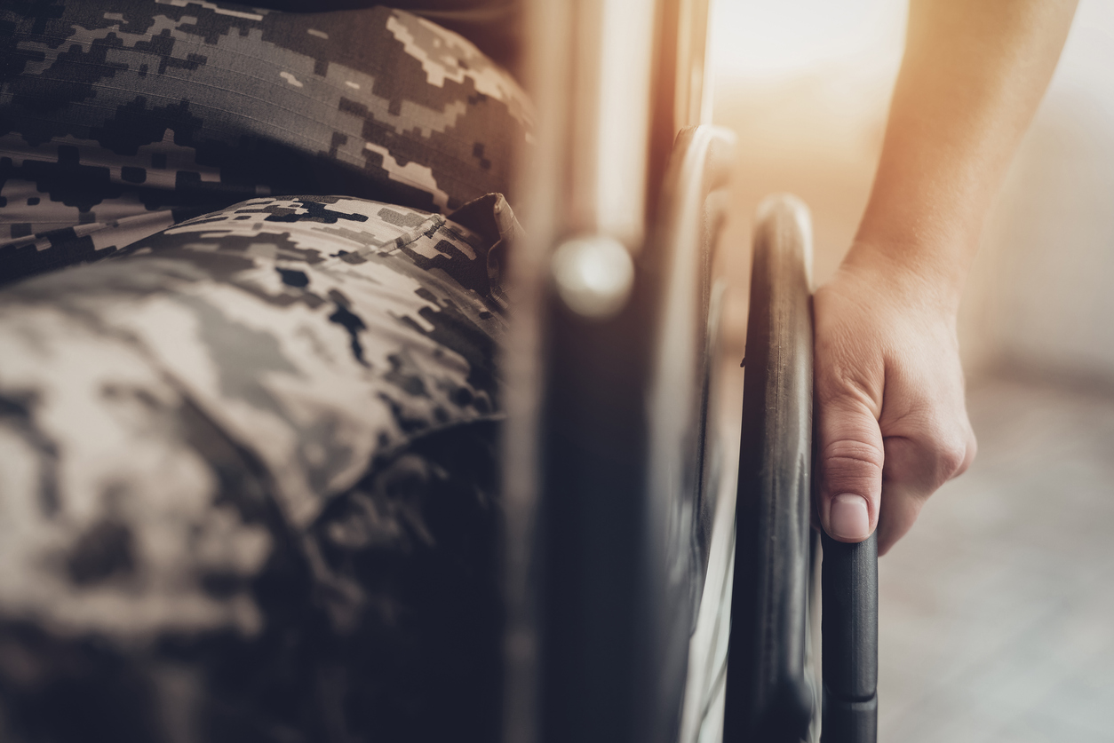 Veteran in a wheelchair receiving disability benefits.