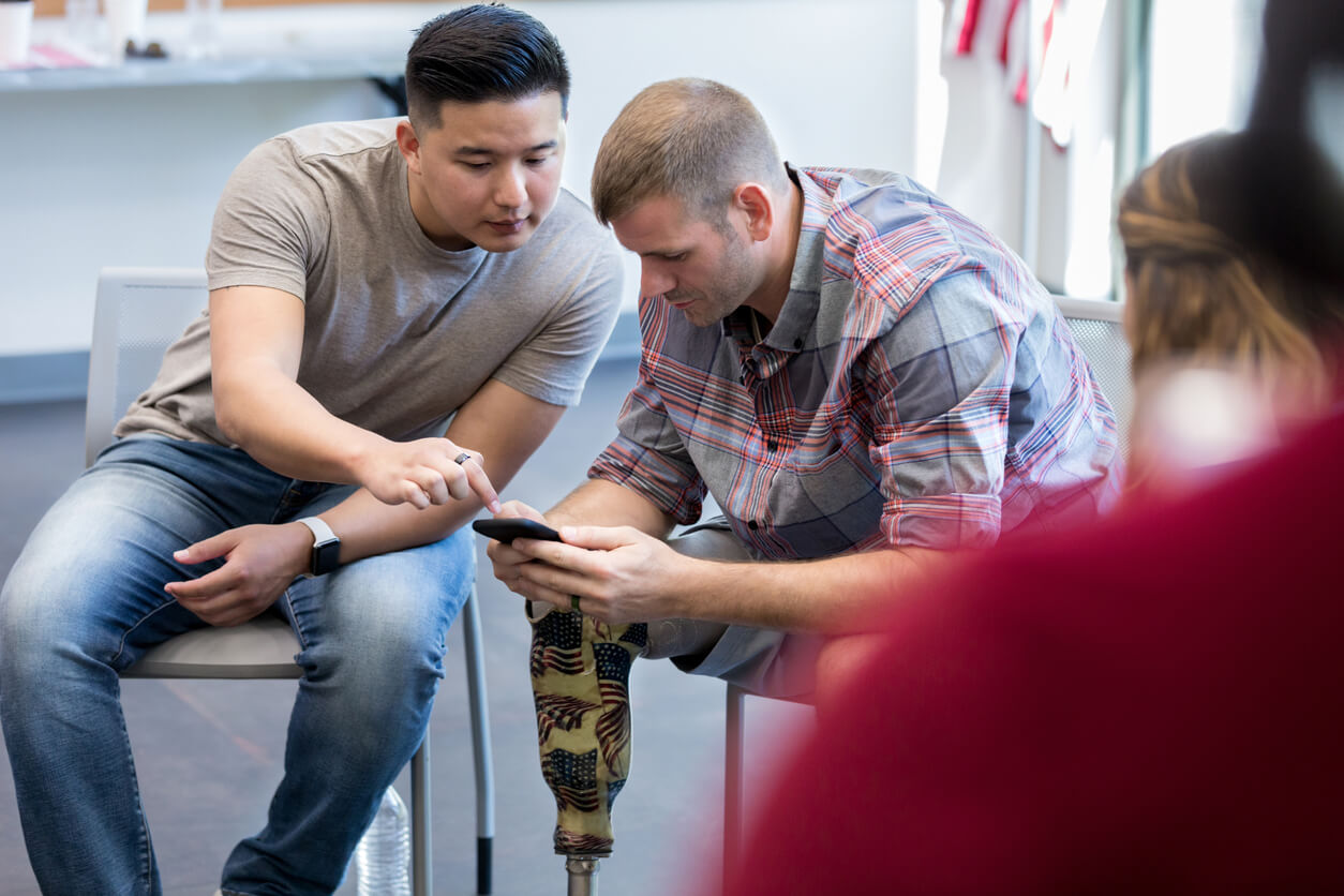 Veteran learning from colleague how to establish service connection with disability.