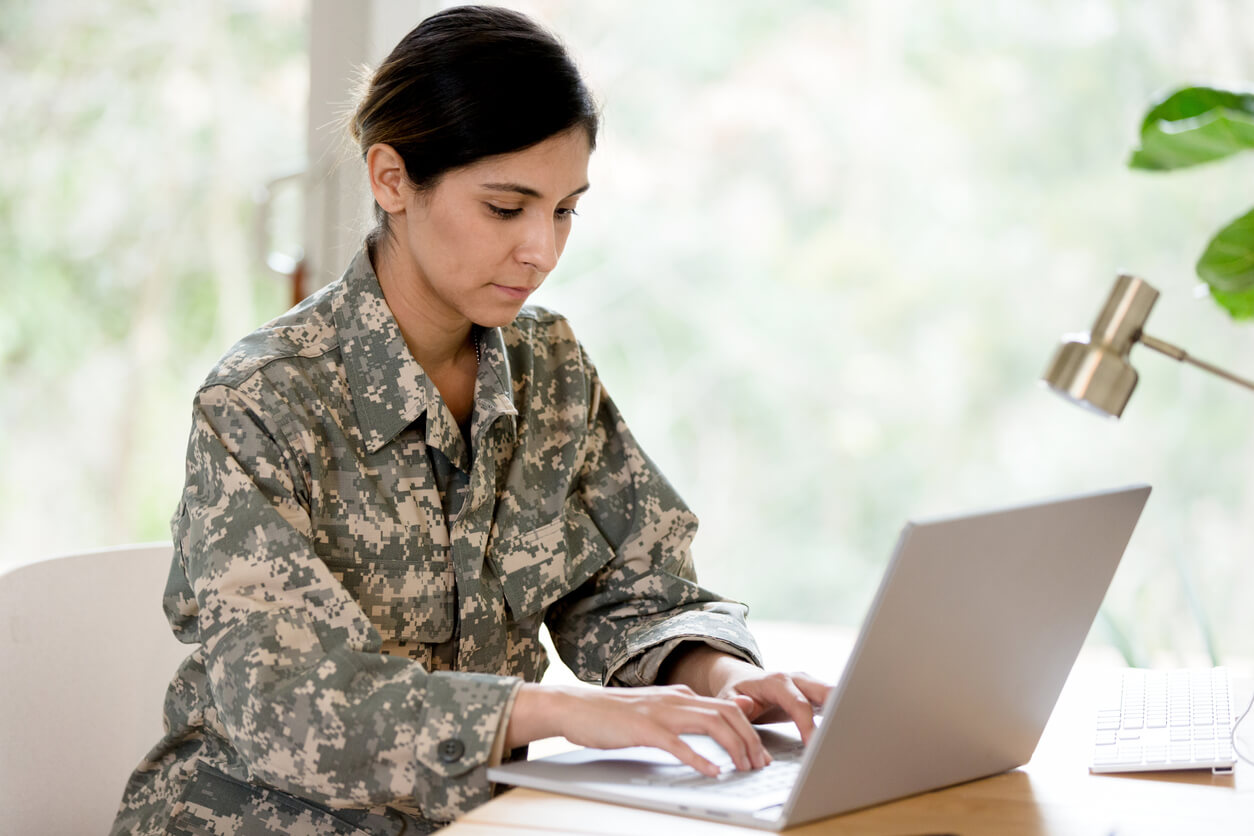 female veteran looking up VA resources